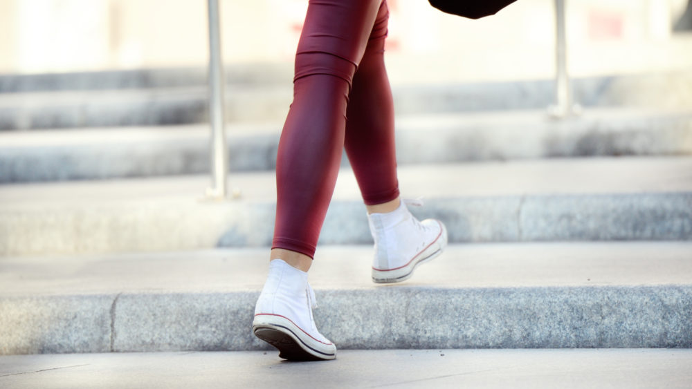 Close up of woman walking up stairs